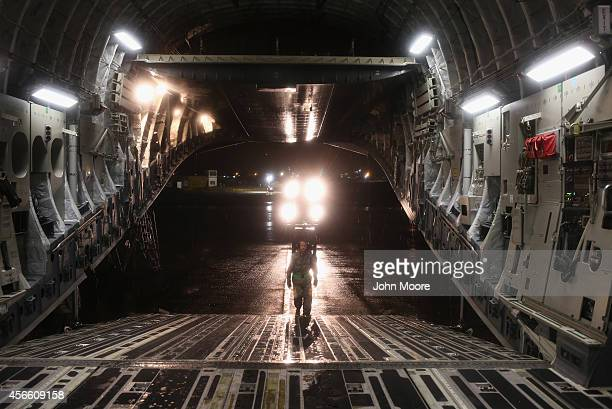 S Air Force personnel offload equipment from a C17 transport plane on October 3 2014 outside of Monrovia Liberia The US military continues to build...