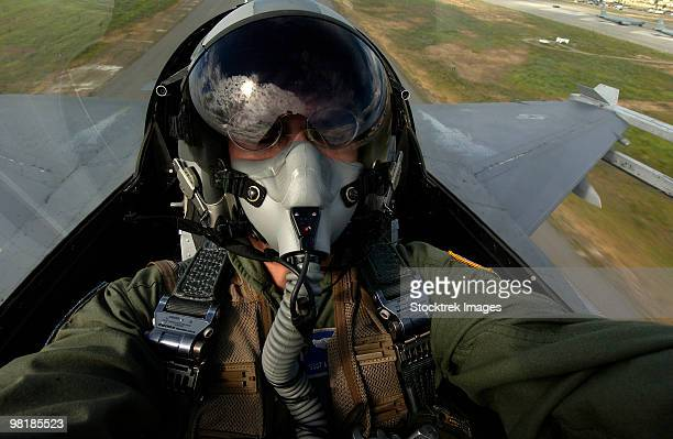 U.S. Air Force pilot looking for nearby aircraft from 45,000 ft up over Eielson Air Force Base, Alas