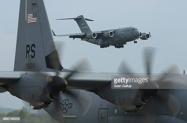 S Air Force planes ferrying men and equipment of the US Army 173rd Airborne Brigade arrive at a Polish air force base on April 23 2014 in Swidwin...