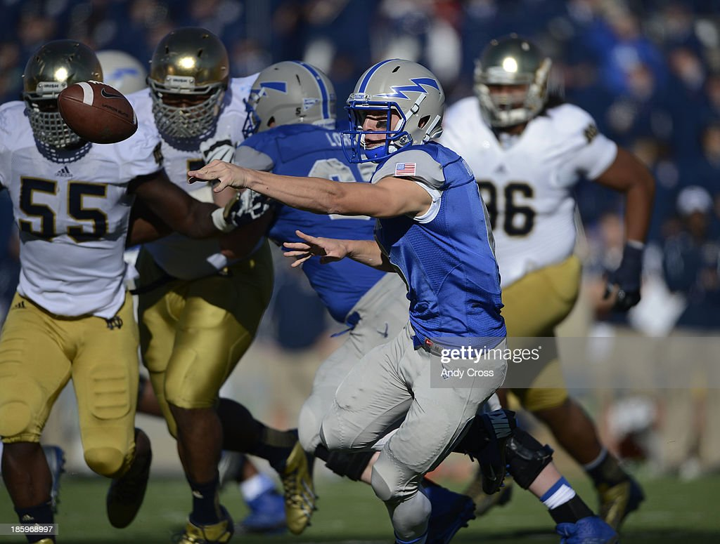 Air Force QB, Nate Romine, pitches the ball during the game against Notre Dame in the first quarter at Falcon Stadium, Saturday afternoon, October 26, 2013.