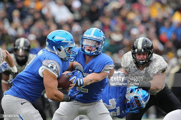 Air Force quarterback Kale Pearson hands off to running back Jacobi Owens during the Army Black Knights Vs Air Force Falcons College Football match...