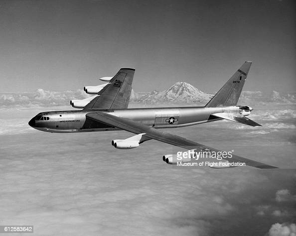 A US Air Force RB52B Stratofortress strategic bomber flying by scenic Mt Rainier during the mid1950's