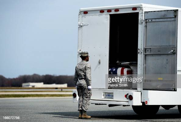 S Air Force Senior Airman and Door Guard for the Transfer Vehicle Tameca Burnett shuts the doors on the transfer vehicle after US Army soliders...