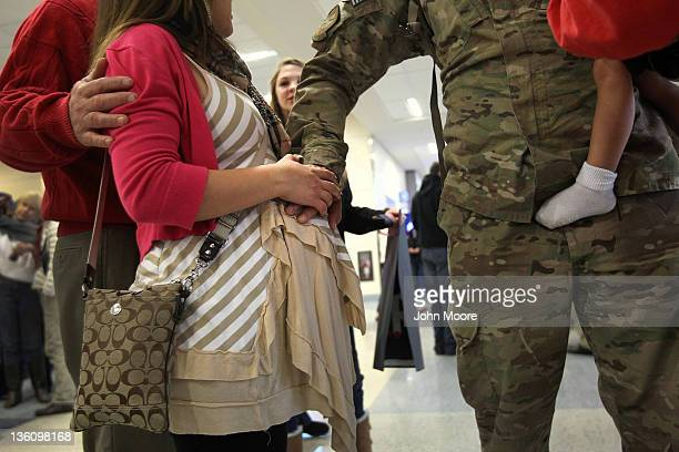 S Air Force Senior Airman Eric Hanson touches the belly of his pregnant wife Masuka Hanson after arriving home from Afghanistan at the Dallas/Fort...