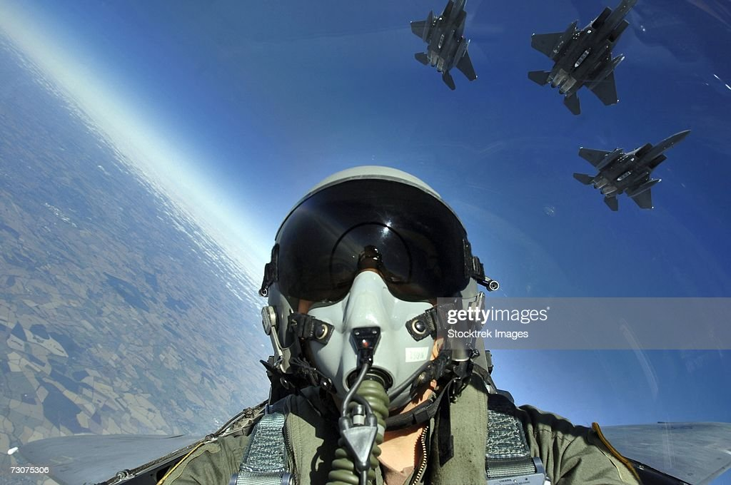 U.S. Air Force sergeant photographed a three-ship formation of F-15E Strike Eagle aircraft from Royal Air Force Lakenheath, England, August 3, 2006.