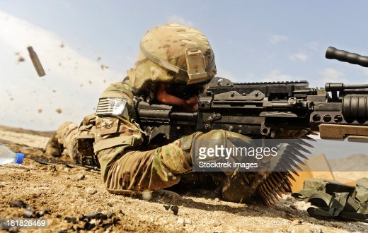 U.S. Air Force soldier fires the Mk48 super SAW machine gun.
