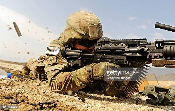 U.S. Air Force soldier fires the Mk48 super SAW machine gun.
