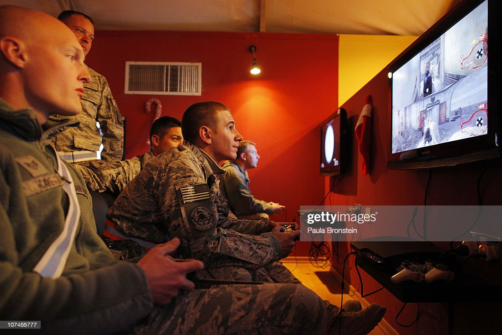 Air Force Staff Sargent Ryan Propst (center) plays 'Call of Duty' video game with a small group of service members at the United Service members Organization (USO) lounge at Kandahar Air Field (KAF) December 8, 2010 in Kandahar, Afghanistan. There are 16,000 NATO troops in Kandahar province and approximately 20-30,000 military and civilian personnel living, working and traveling through Kandahar Air Field (KAF). The base has continued to grow rapidly with a variety of shops, restaurants and cafes. Kandahar Air Field (KAF) has been in operation since 2002 with troops camping out on the floor of a bombed out airport in late 2001 after the U.S lead bombing strike.