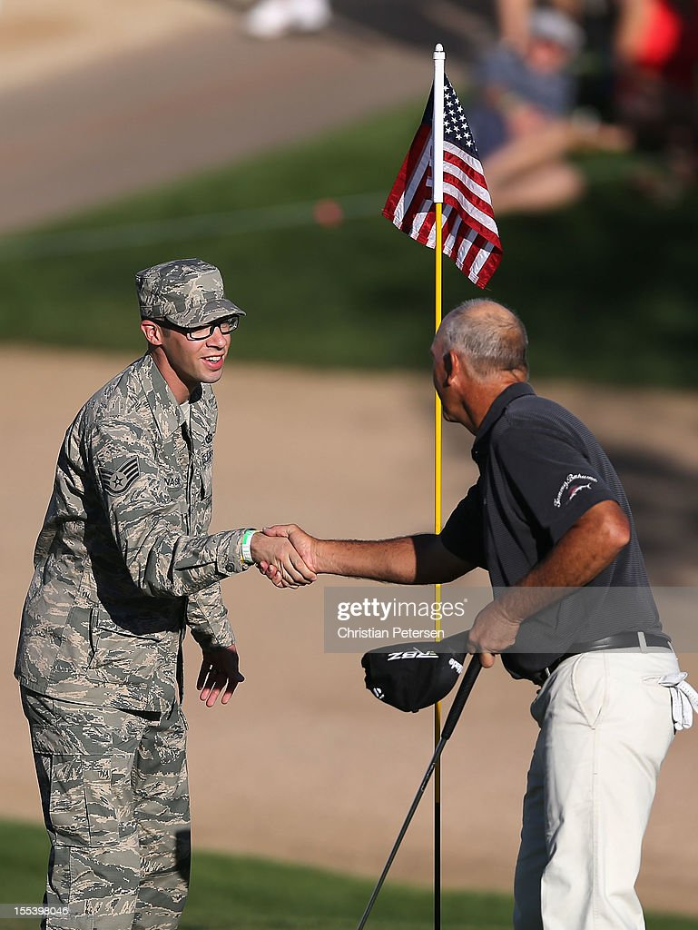 S Air Force Staff Sgt Joshua Nason shakes hands with Tom Lehman on the 18th hole green following the third round of the Charles Schwab Cup...