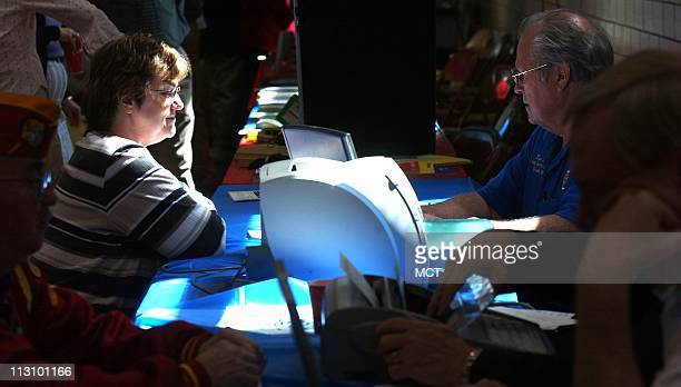 US Air Force veteran Janet Etling left fills out paperwork with advisor Bud Lane in Jefferson City Missouri in April 2004 at an event sponsored by...