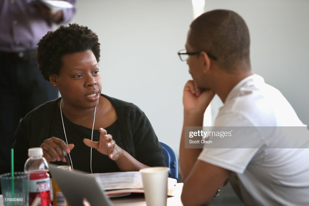 Air Force veteran Lorretta Coleman (L) gets help with her resume from Google MBA intern Justin Turner on June 11, 2013 in Chicago, Illinois. The two were participating in Google's 'Help a Hero Get Hired' career coaching program taking place at Google's Chicago office. The program evolved from a partnership between Google and Student Veterans of America.