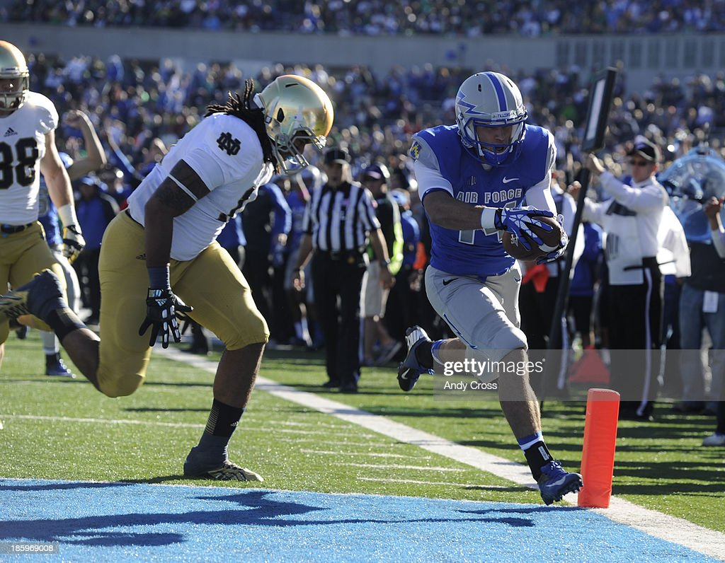 Air Force WR, Colton Huntsman, right, crosses the goal line for a touch down against Ishaq Williams, Notre Dame, in the first quarter of play at Falcons Stadium Saturday afternoon, October 26, 2013.