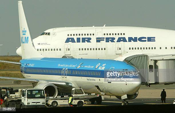 Air France and KLM aircrafts are shown on the tarmac at Terminal 1 of Charles de Gaulle airport September 30 2003 in Roissy France Air France is to...