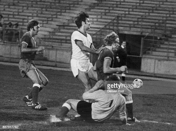 Air France Attack Cut Short This Time Colorado AllStar goalie Robert McGee of Cafe Promenade slips to ground to help fend off Air France attack at...