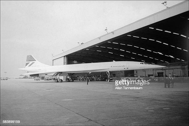 Air France / British Airways Concorde towed to hangar after landing at JFK Airport after first supersonic transatlantic flight New York New York...