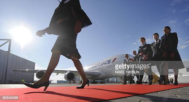 Air France crew members walk down the red carpet after the A380 was handed over by Airbus in Hamburg on October 30 2009 The European Aircraft...