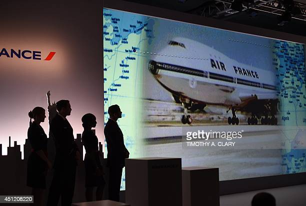 Air France flight attendants looks at a slide show in New York June 25 2014 Air France held a news conference unveiling the new Upscale Experience on...