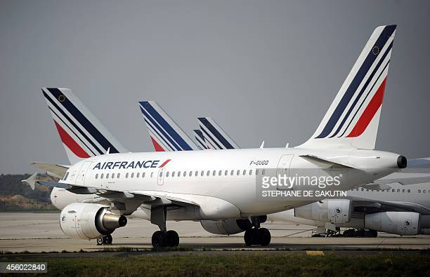 Air France planes are parked on the tarmac of Charles de Gaulle airport on September 24 2014 in Roissy during an Air France pilots strike AFP PHOTO /...