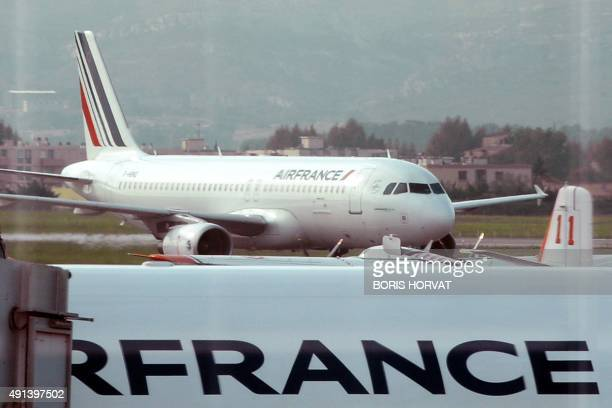 Air France planes are pictured on the tarmac of the MarseilleProvence airport on October 5 2015 in Marignane as Air FranceKLM unveiled a revamped...