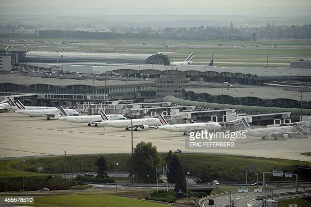 Air France planes that will be flying today are parked on the tarmac at ParisCharles de Gaulle airport in Roissy on September 17 2014 Air France...