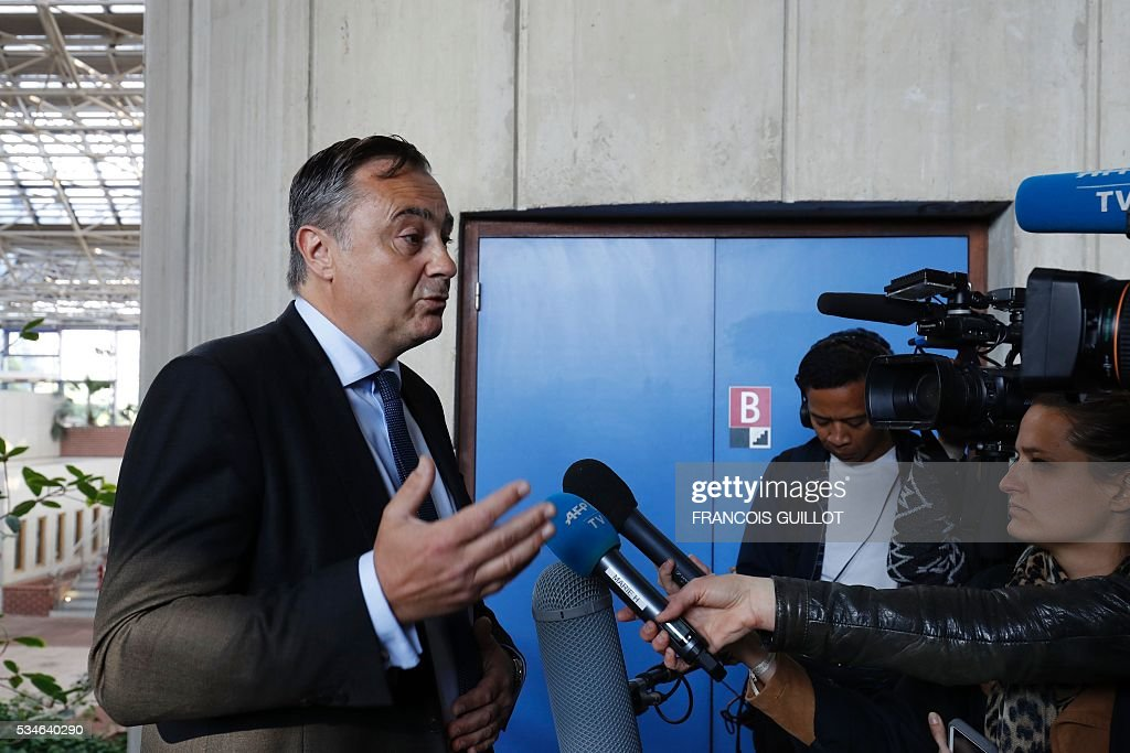 Air France's director of Legal Affairs Franck Raimbault speaks to journalists at to the court of Bobigny, northern Paris on May 27, 2016 during the trial of 15 French CGT union's members judged for the episode of the torn shirt, in full showdown initiated by the union with the government on labor law. On October 5, 2015 under the cries of naked, naked and resignation , the Air France human resources director found himself shirtless, tattered shirt during a protest after the announcement of a restructuring of the airline threatening nearly 3,000 jobs.