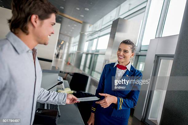 Air hostess at boarding time