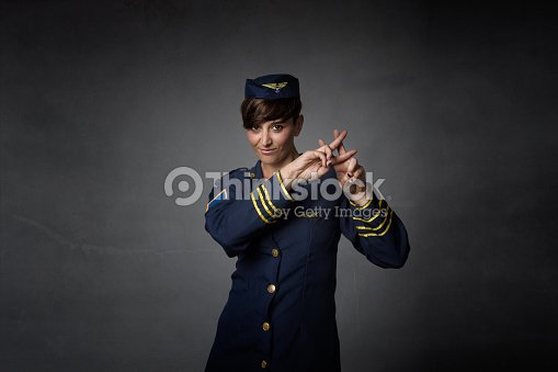 Air Hostess Gesturing Hashtag Symbol Stock Photo Thinkstock