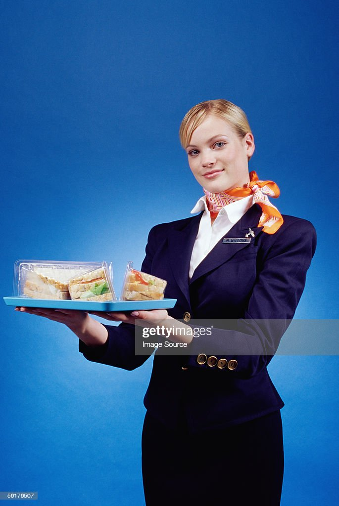 Air hostess holding a tray of sandwiches