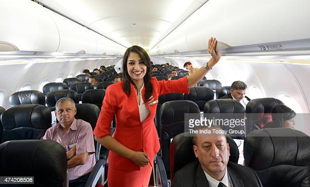 Air Hostess inside the Aeroplane during the launch of Air Asia flight at IGI AirportT3 New Delhi