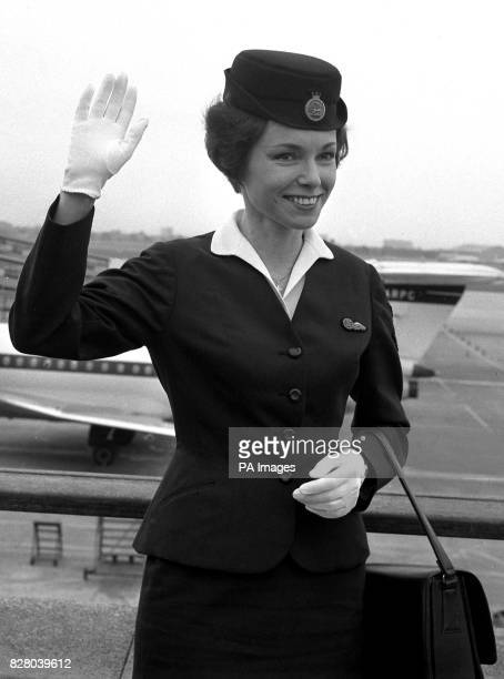BOAC air hostess Irena Zielinska waves a farewell at London Airport as she leaves for Moscow to represent the airline at the forthcoming British...