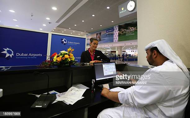 A air hostess of the low cost Hungarian Wizz Air waits for her passport to be stamped at the newly opened AlMaktoum International airport the...