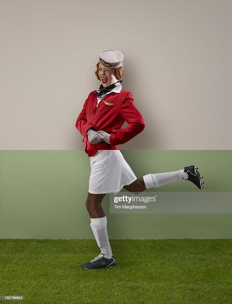 Air hostess top, footballer bottom : Stock Photo