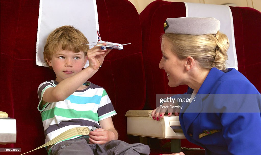 Air hostess with child on plane : Stock Photo