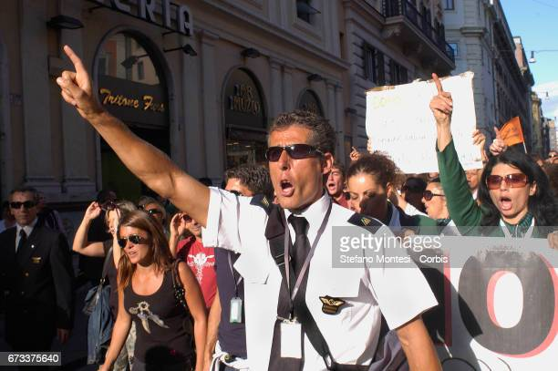 Air hostesses and employees of Italy's flag carrier Alitalia demonstrate in front of the Italian Prime Ministry the Palazzo Chigi Lastgasp...
