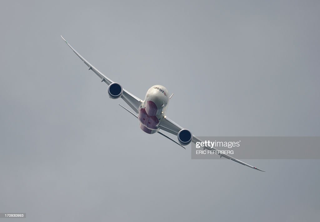A Air India Boeing Dreamliner flies over Le Bourget airport, near Paris on June 20, 2013 during the 50th International Paris Air show.