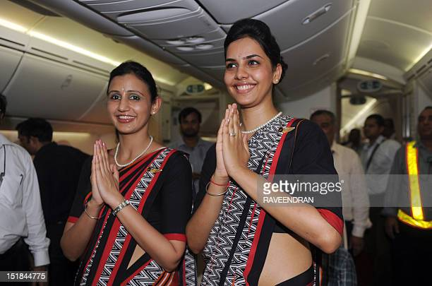 Air India flight attendants pose for a photo during the unveiling of Air India's first Boeing 787 Dreamliner at Indira Gandhi International airport...