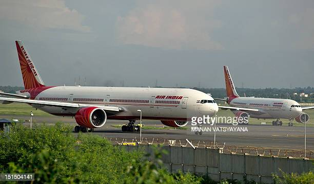 Air India planes prepare for takeoff at the Indira Gandhi International Airport in New Delhi on September 8 2012 Boeing hiked its forecast for...