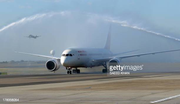 Air India's Dreamliner gets water cannon salute after touching down at Sydney airport on August 30 2013 Australia's first ever Dreamliner passenger...