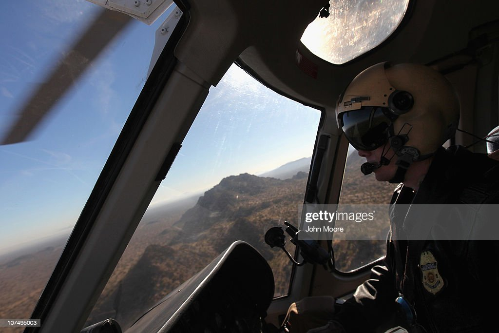 Air interdiction agent Jake Linde from the U.S. Office of Air and Marine flies over the Sonoran Desert while searching for illegal immigrants and drug smugglers on December 9, 2010 in the Tohono O'odham Reservation, Arizona. The federal agency works closely with the U.S. Border Patrol in searching for smugglers and illegal immigrants who cross in remote areas all along the U.S.-Mexico border.