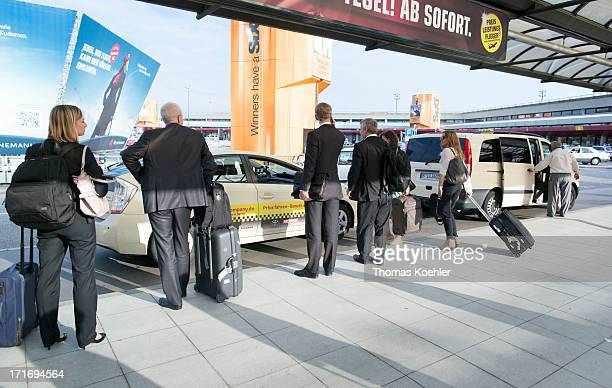 Air passengers waiting for a taxi outside arrivals at Tegel Airport pictured on May 08 2013 in Berlin Germany