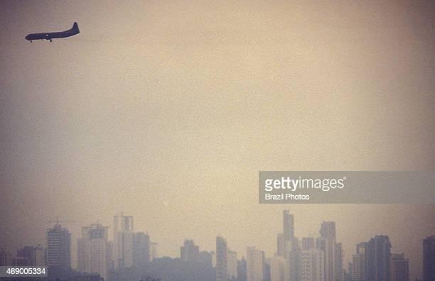 Air pollution Airplane flies over São Paulo city Brazil