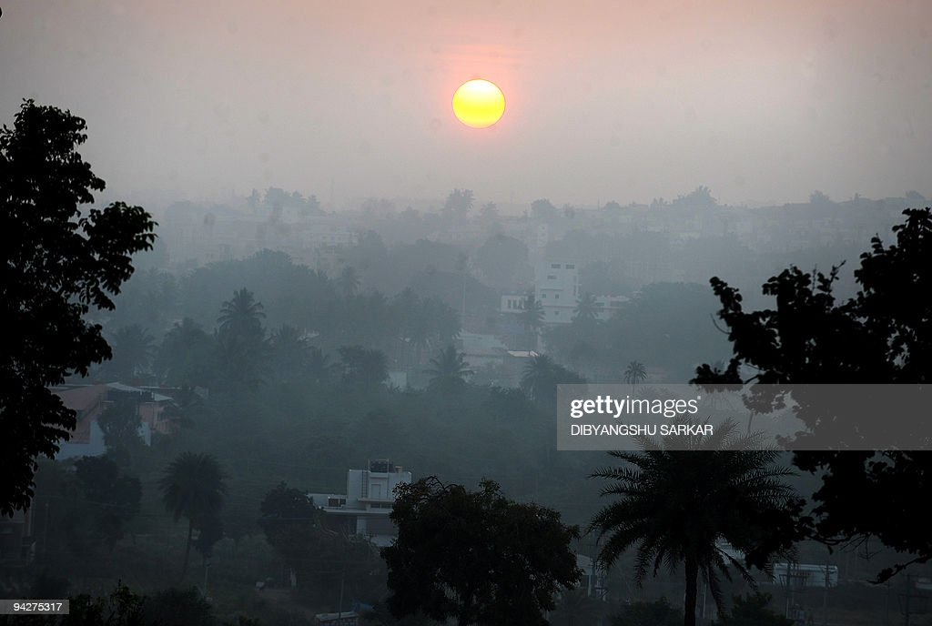Air pollution and haze cast a blanket over a residential area of Bangalore on December 11 2009 India like other emerging world economies is under...