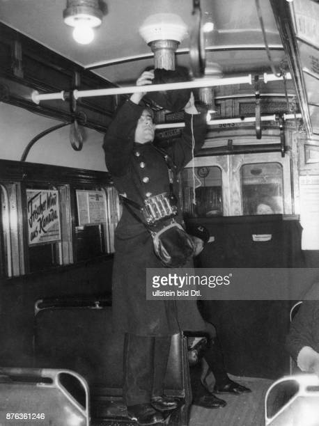 Air Raid Precautions of the Reichsluftschutzbund in Berlin the blackout A conductor obscures the light in a driving tramway