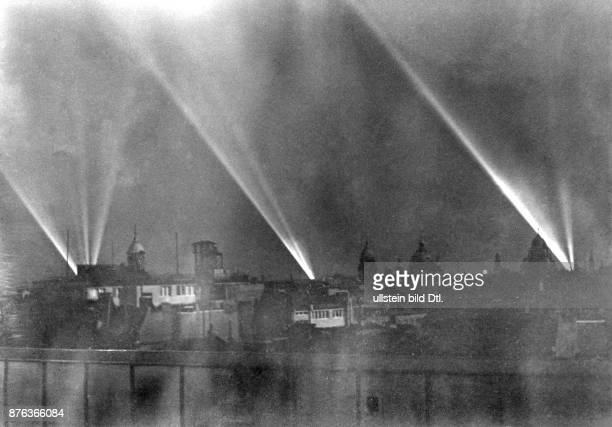 Air Raid Precautions of the Reichsluftschutzbund in Berlin the blackout Headlights visible at the sky at night Vintage property of ullstein bild