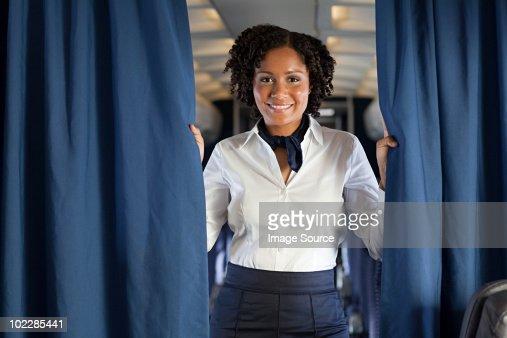 Air stewardess with curtain