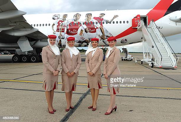 Air stewards pose for picture in front of the Arsenal's Emirates plane as they travel to Singapore for the Barclays Asia Trophy at Stansted Airport...