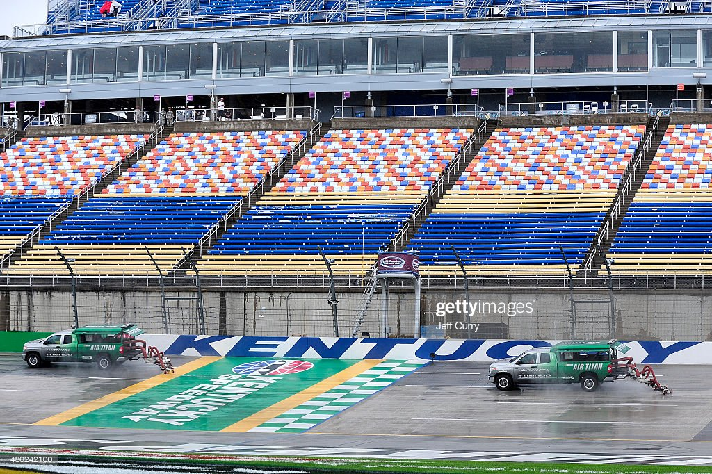 Air Titan 20 trucks work to dry the track during a rain delay in practice for the NASCAR Sprint Cup Series Quaker State 400 Presented by Advance Auto...