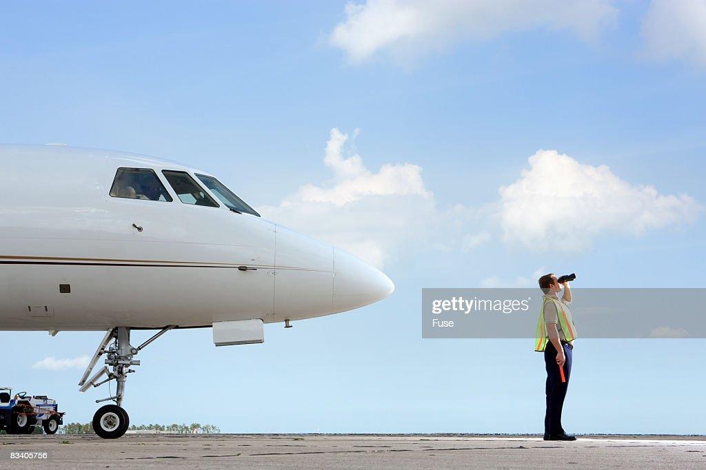 Air Traffic Control Worker Looking Through Binoculars