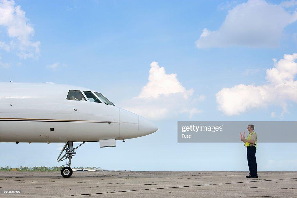 Air Traffic Control Worker on Runway