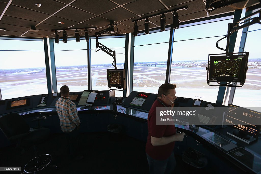 Air Traffic Controller, David Spitnale,(R) and Robert Moreland work in the control tower at Opa-locka airport on March 4, 2013 in Opa-locka, Florida. Due to sequestration cuts, small airports such as Opa-locka, which is a popular spot for corporate jets to land, will close its control tower in April to save federal transportation dollars under the federal spending cuts that went in to affect last week. Even though the control tower will close, planes will still be able to use the airport just without the help from the control tower.